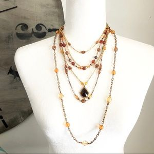 Bundle of two amber bead /  gold tone necklaces.